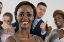 Image of African-American female business leader in front of her business team